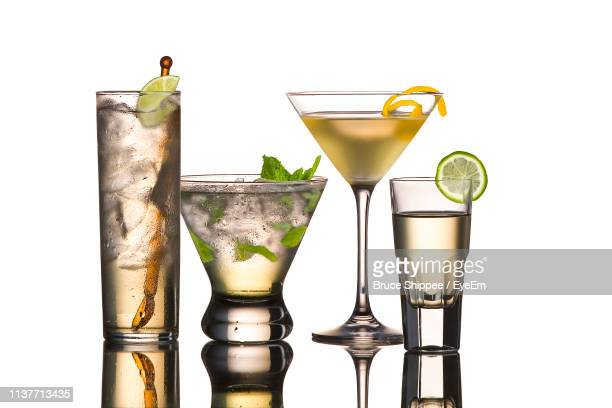 close-up of cocktail glasses against white background - martini glass stock pictures, royalty-free photos & images