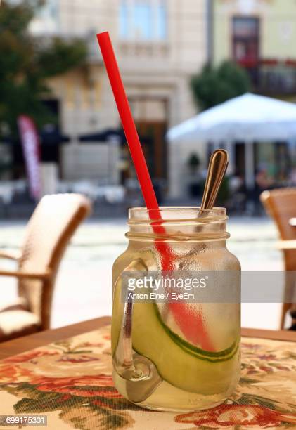 Close-Up Of Cocktail In Glass Jar On Table At Restaurant