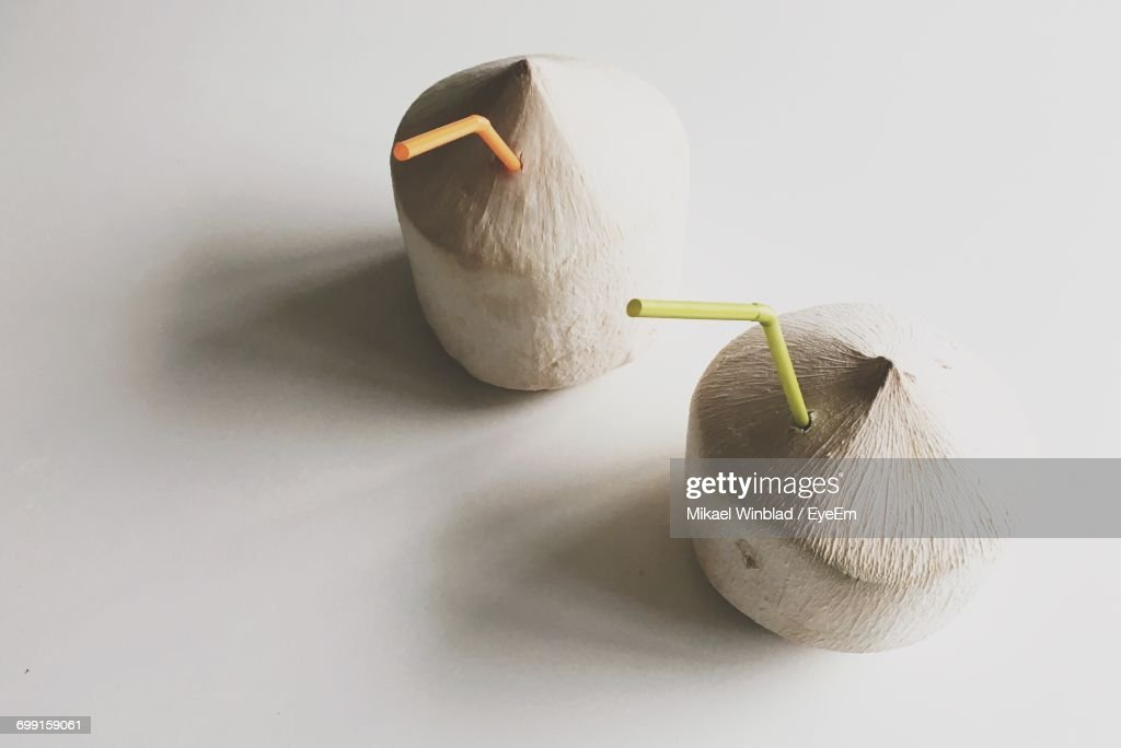 Close-Up Of Coconut Drinks On White Background : Foto stock
