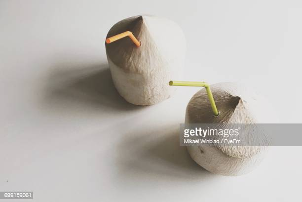 Close-Up Of Coconut Drinks On White Background