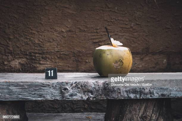 close-up of coconut on wooden table - coconut water stock pictures, royalty-free photos & images
