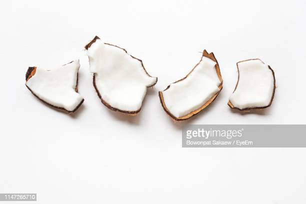 close-up of coconut slices over white background - slice of food stock pictures, royalty-free photos & images