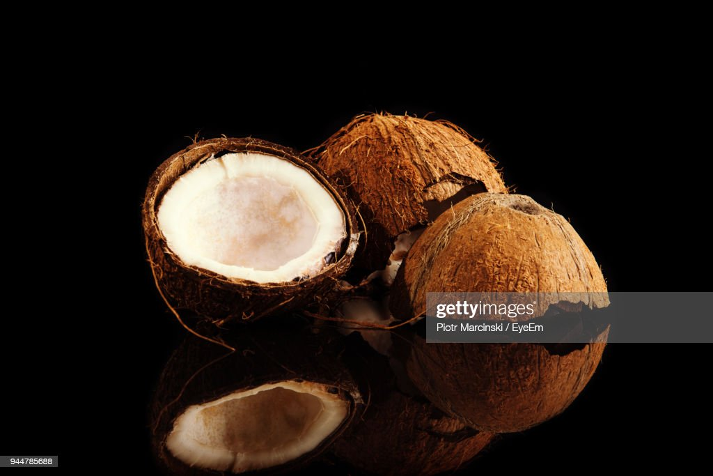 Close-Up Of Coconuts Over Black Background : Stock Photo