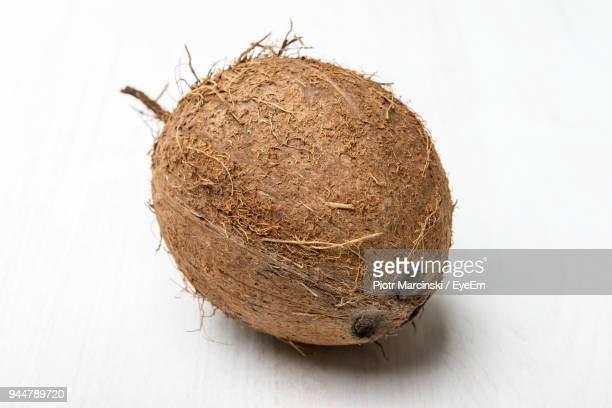 Close-Up Of Coconuts Over White Background