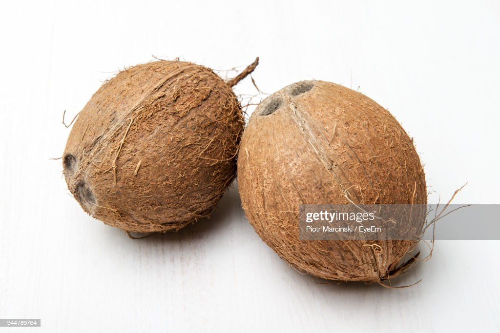 Close-Up Of Coconuts Over White Background : Stock Photo