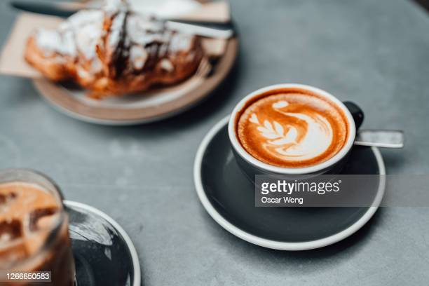close-up of coffee and almond croissant served on the table - breakfast stock pictures, royalty-free photos & images