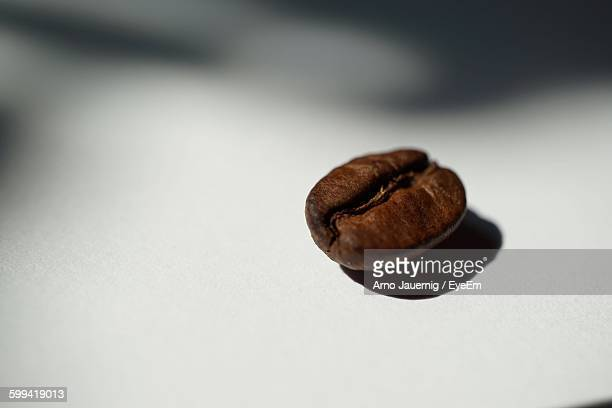 Close-Up Of Coffee Bean Over White Background