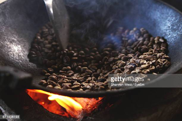 Close-Up Of Coffee Beans Being Roasted In Pan