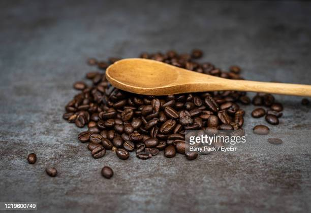 close-up of coffee beans on table - barry wood stock pictures, royalty-free photos & images