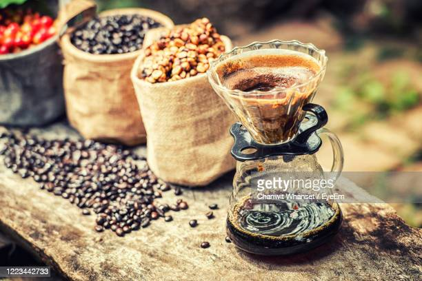 close-up of coffee beans on table - civet cat stock pictures, royalty-free photos & images