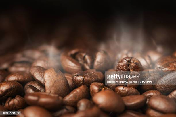 close-up of coffee beans - roasted coffee bean stock photos and pictures