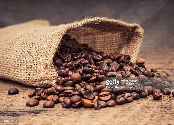 Close-Up Of Coffee Beans Spilling From Sack