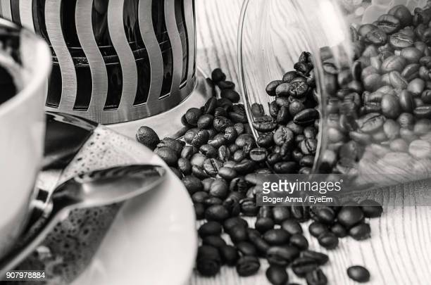Close-Up Of Coffee Beans Spilling On Table