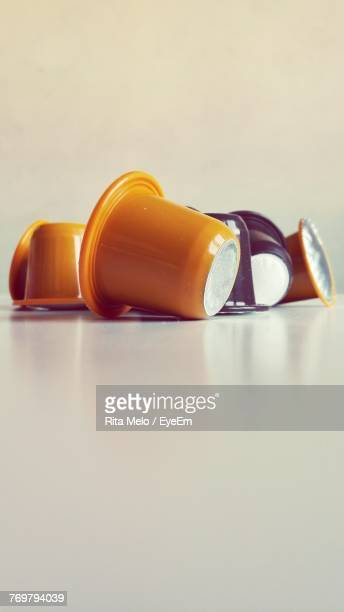 Close-Up Of Coffee Capsules Against White Background