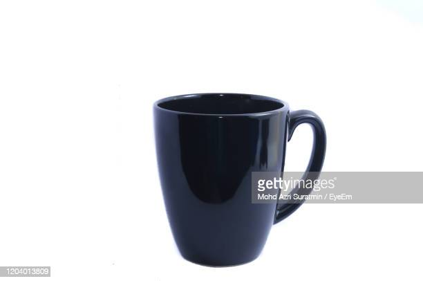 close-up of coffee cup against white background - cup stock pictures, royalty-free photos & images