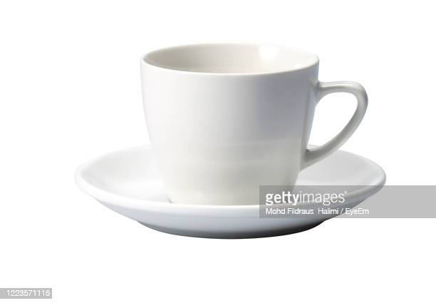 close-up of coffee cup against white background - saucer stock pictures, royalty-free photos & images