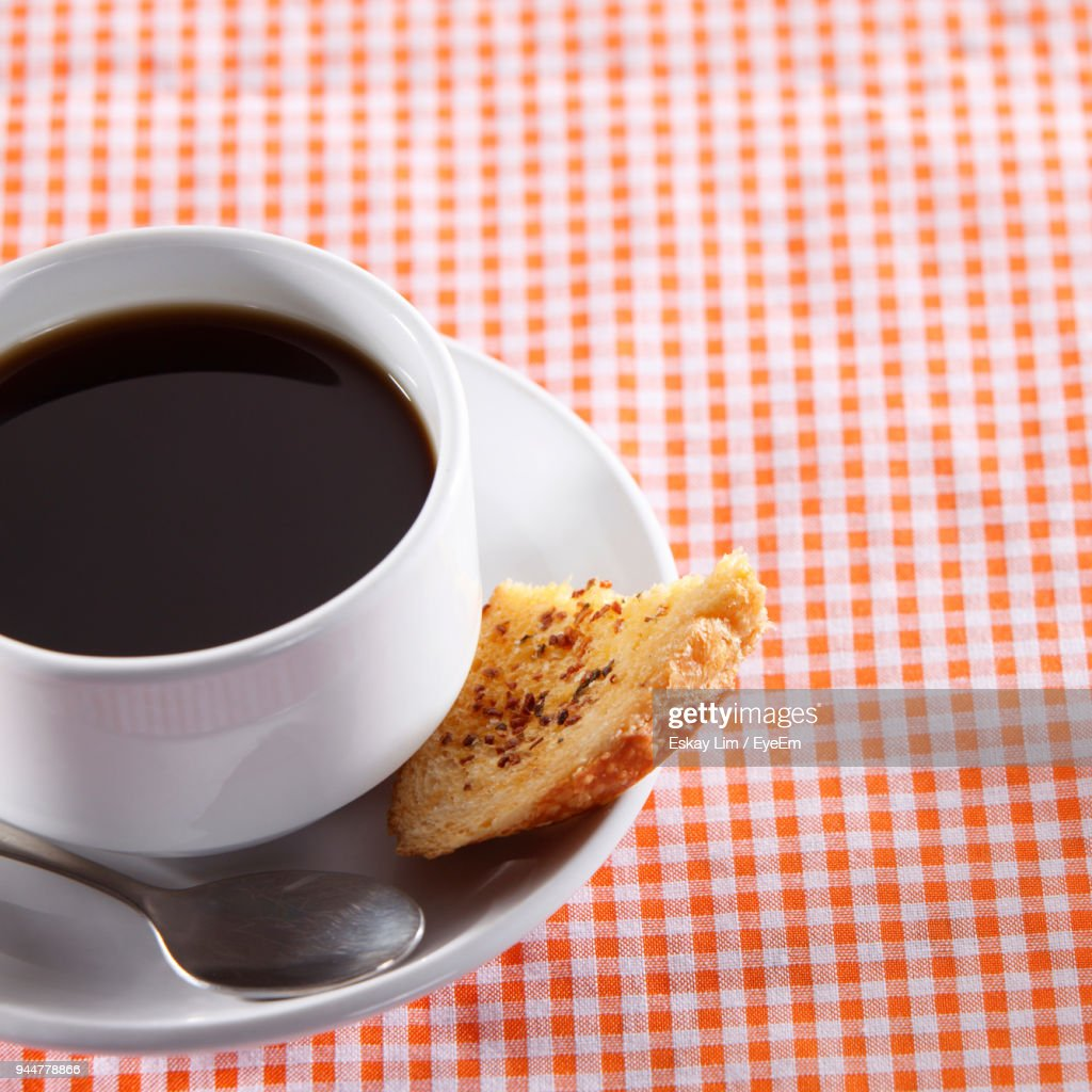 Close-Up Of Coffee Cup And Garlic Bread On Table : Stock Photo