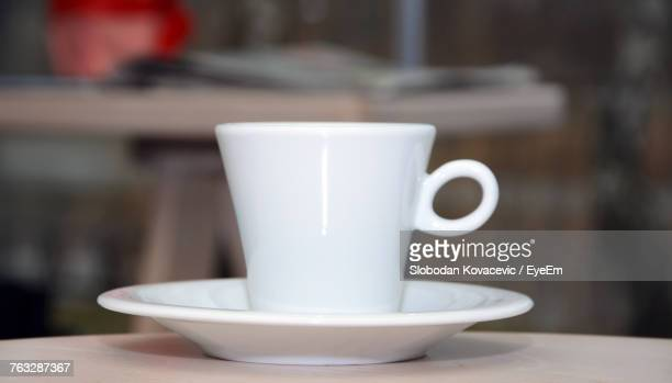 Close-Up Of Coffee Cup And Saucer On Table