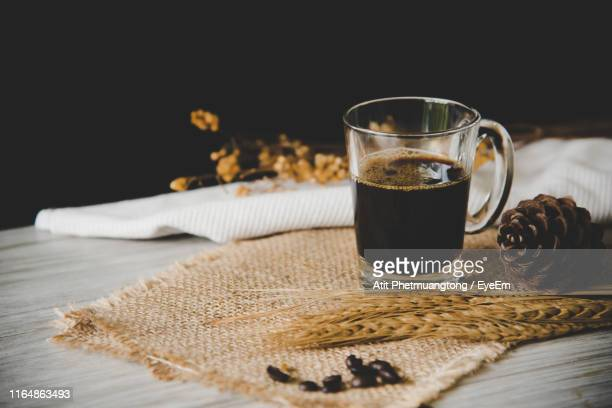 close-up of coffee cup on burlap - black coffee stock pictures, royalty-free photos & images