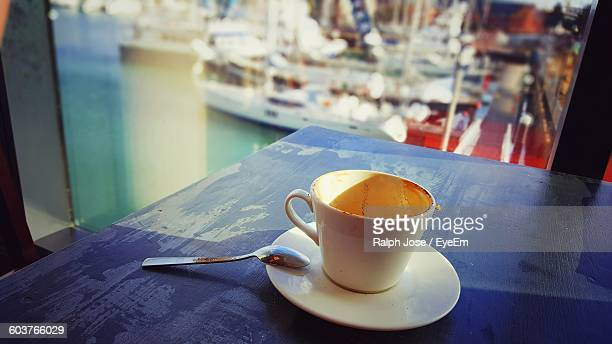 close-up of coffee cup on table against window - southampton england stock pictures, royalty-free photos & images
