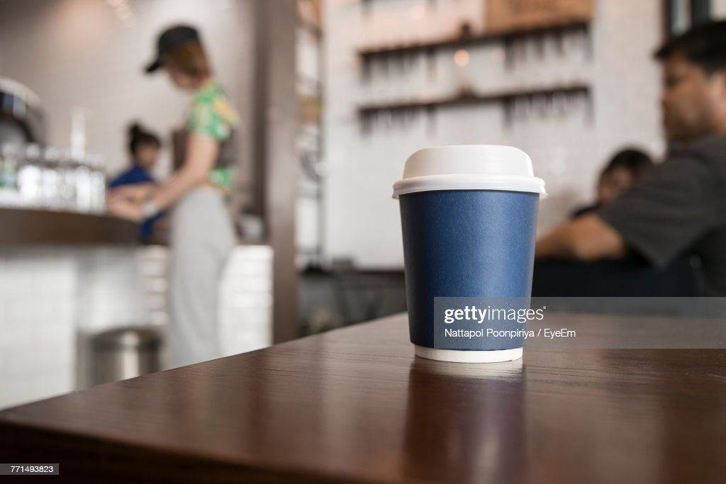 Close-Up Of Coffee Cup On Table At Cafe : Stock Photo