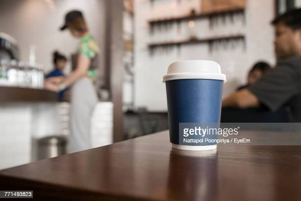 Close-Up Of Coffee Cup On Table At Cafe