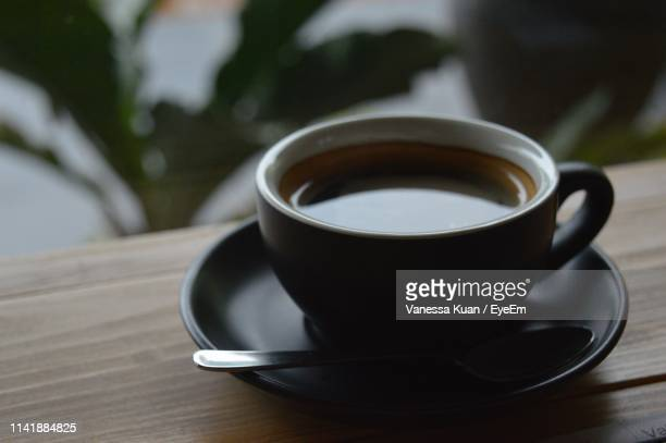 close-up of coffee cup on table - black coffee stock pictures, royalty-free photos & images