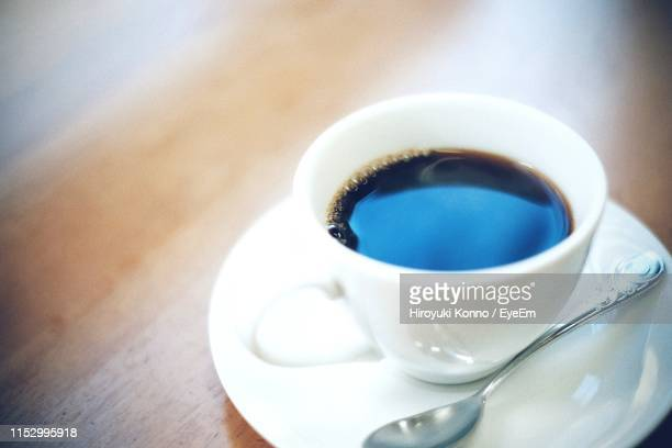 close-up of coffee cup on table - saucer stock pictures, royalty-free photos & images