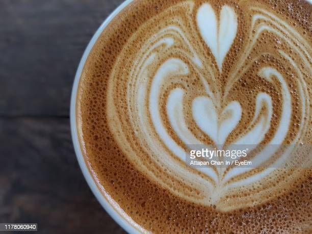 close-up of coffee cup on table - cappuccino stock pictures, royalty-free photos & images