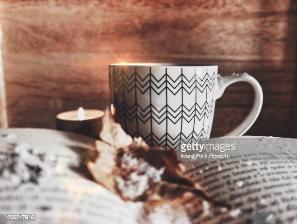 close-up of coffee cup on table - hygge stock-fotos und bilder