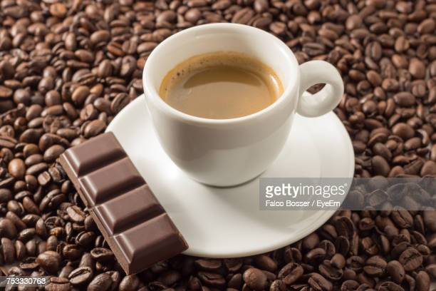 close-up of coffee cup on table - mocha stock photos and pictures
