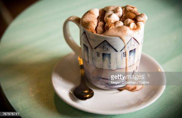 close-up of coffee cup on table - hot chocolate stock pictures, royalty-free photos & images