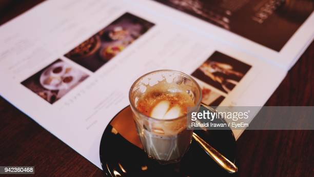 close-up of coffee cup on table - glass magazine stock photos and pictures