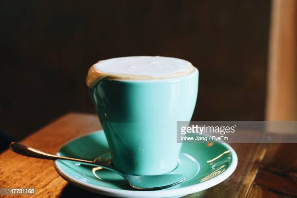 close-up of coffee cup on wooden table - saucer stock pictures, royalty-free photos & images