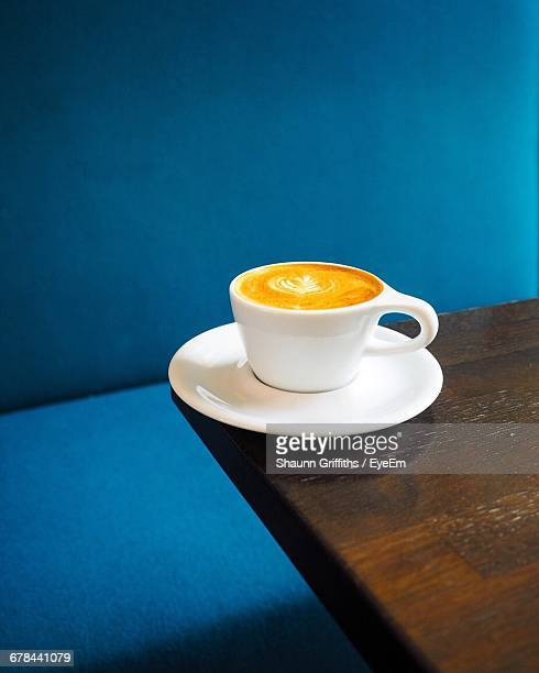 Close-Up Of Coffee Cup On Wooden Table