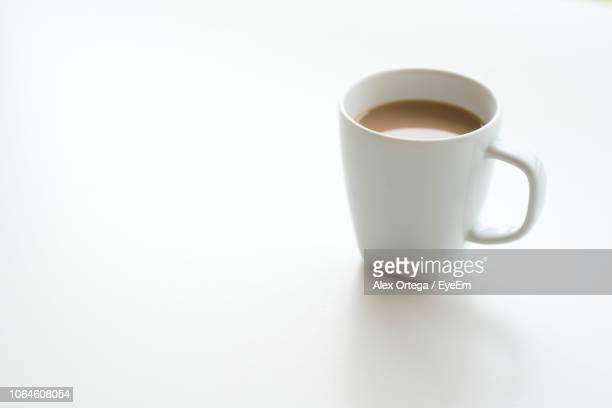 Close-Up Of Coffee Cup Over White Background