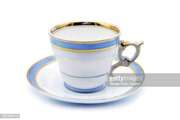 close-up of coffee cup over white background - saucer stock pictures, royalty-free photos & images