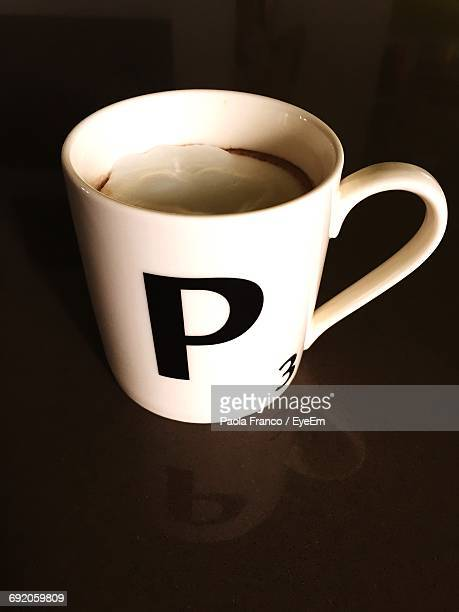 close-up of coffee cup - letter p stock pictures, royalty-free photos & images