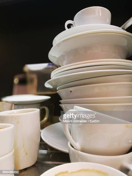 Close-Up Of Coffee Cups And Bowls On Table