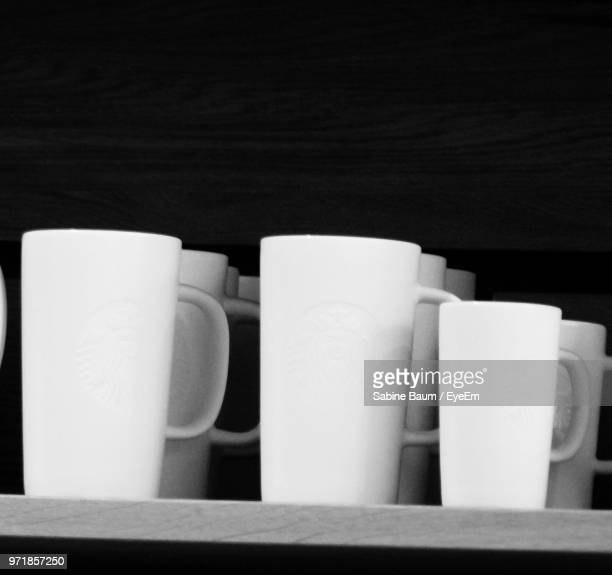 close-up of coffee cups on table against black background - baum stock pictures, royalty-free photos & images