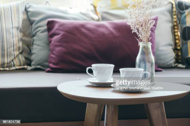 close-up of coffee cups on table - saucer stock pictures, royalty-free photos & images