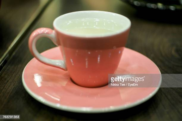 Close-Up Of Coffee Cups With Saucer On Table