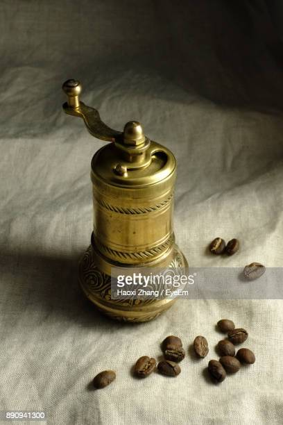 Close-Up Of Coffee Grinder And Beans On Jute