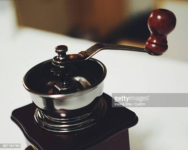 Close-Up Of Coffee Grinder On Table At Home