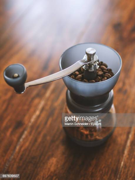 close-up of coffee grinder on table - coffee grinder stock photos and pictures