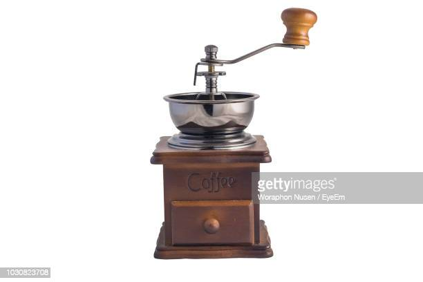 close-up of coffee grinder over white background - coffee grinder stock photos and pictures