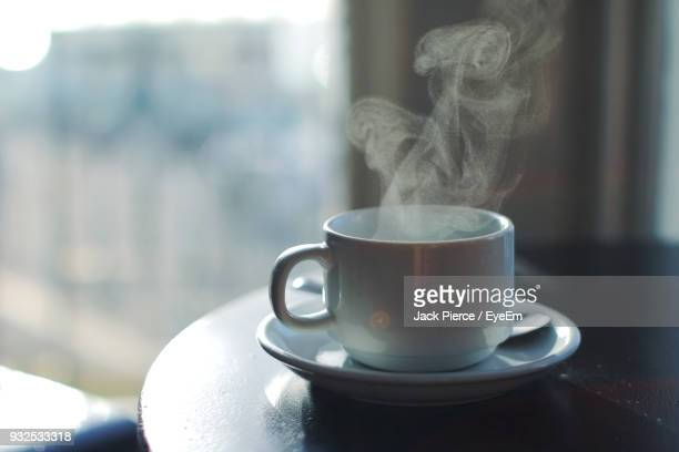 close-up of coffee in cup on table - steam stock pictures, royalty-free photos & images