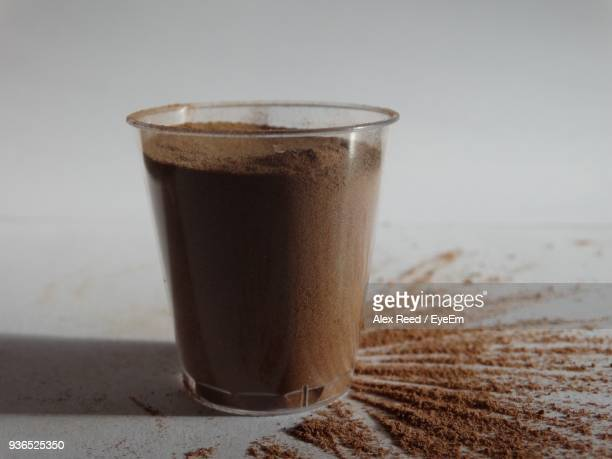 Close-Up Of Coffee In Drinking Glass On Table