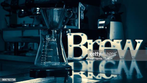 Close-Up Of Coffee Maker On Table In Cafe
