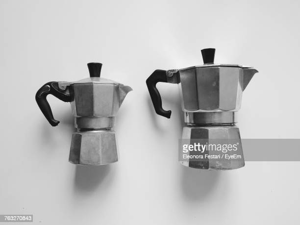 Close-Up Of Coffee Makers Against White Background